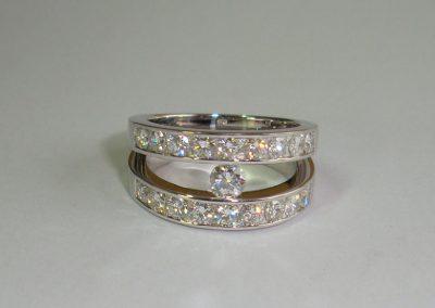 Bague double anneau diamants + diamant central