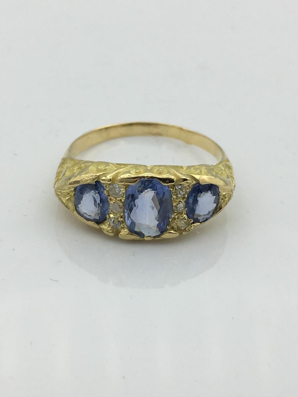 Bague or saphirs et diamants